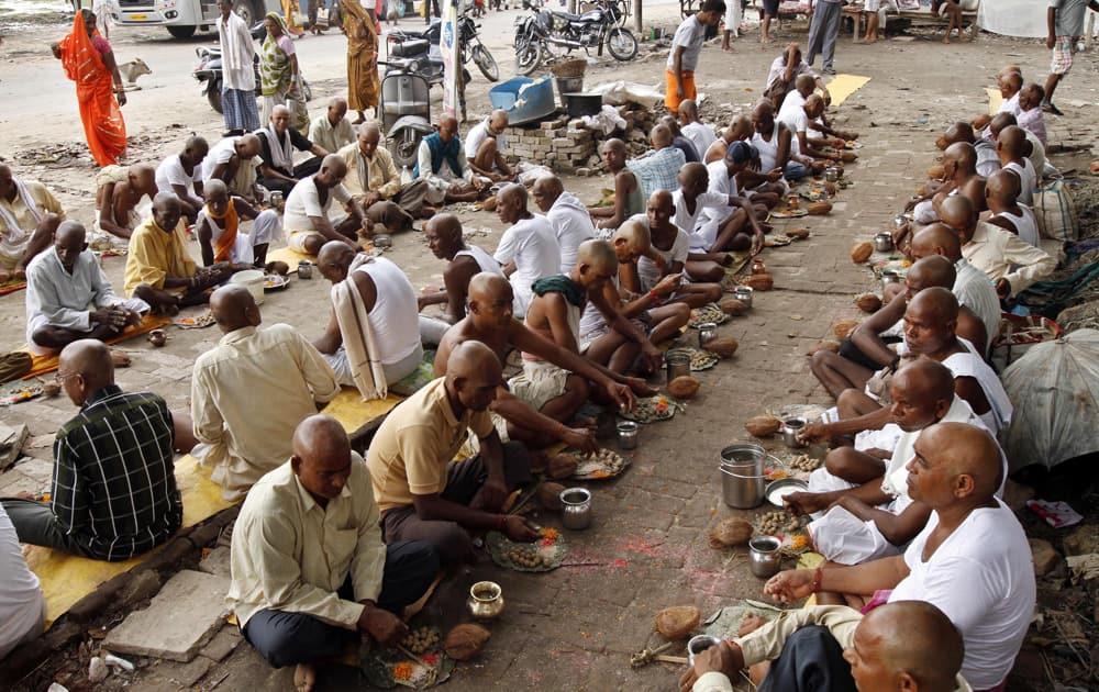 Hindu devotees perform