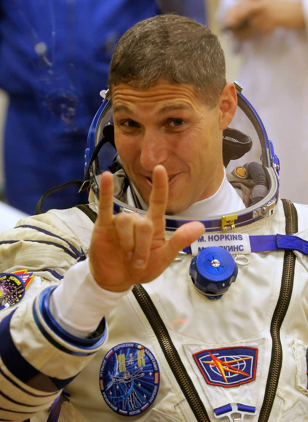 US astronaut Michael Hopkins, crew member of the mission to the International Space Station, ISS, gestures prior the launch of Soyuz-FG rocket at the Russian leased Baikonur cosmodrome, Kazakhstan.