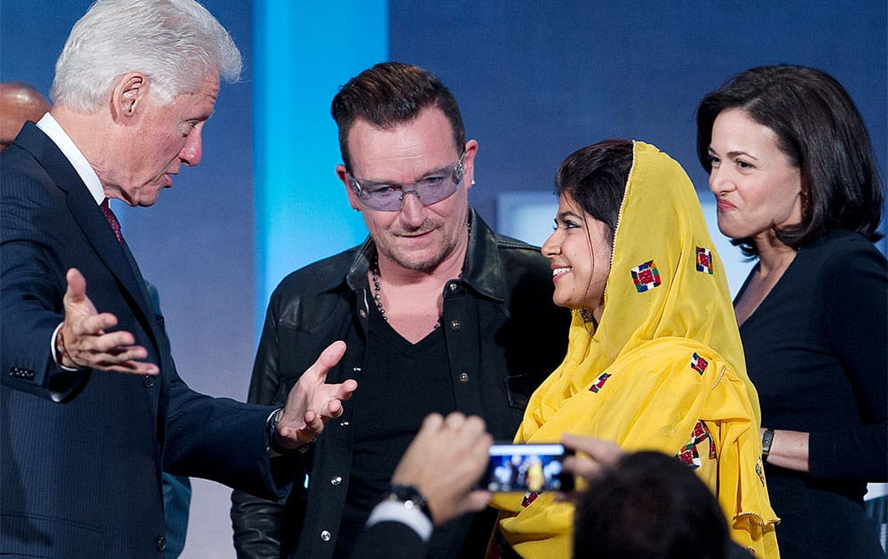 Former President Bill Clinton, left, talks with Bono, Khalida Brohi, founder of the Sughar Empowerment Society, and Sheryl Sandberg, the chief operating officer of Facebook, at the Clinton Global Initiative, in New York. Clinton moderated their panel discussion on