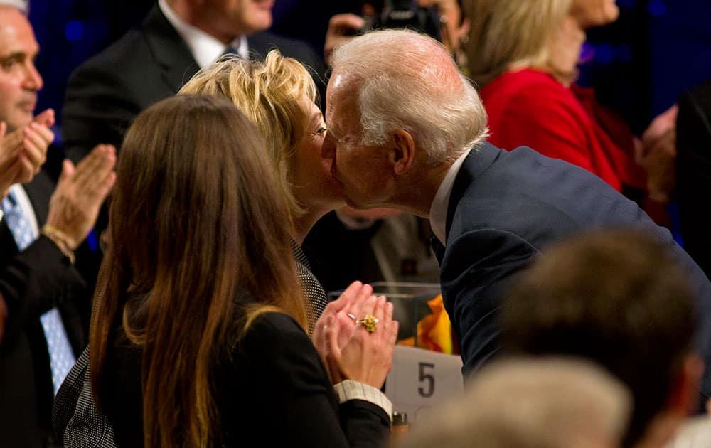 Vice President Joe Biden kisses former U.S. Secretary of State, Hillary Rodham Clinton, as he arrives at the Clinton Global Initiative`s Citizen Awards Dinner in New York.