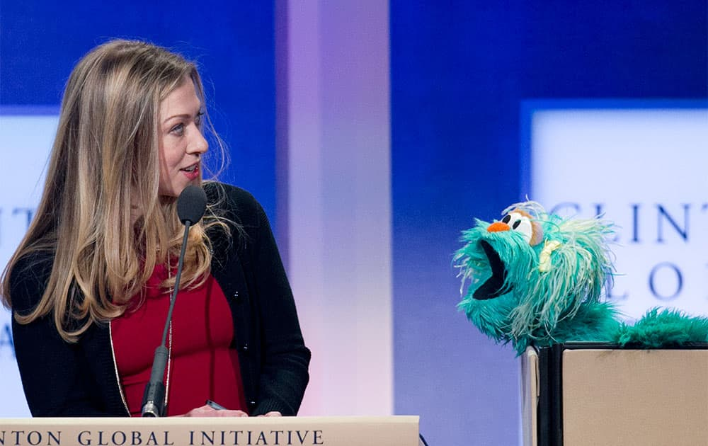Chelsea Clinton, left, reacts to Rosita, a character from Sesame Street, at the Clinton Global Initiative in New York. Clinton moderated a panel on