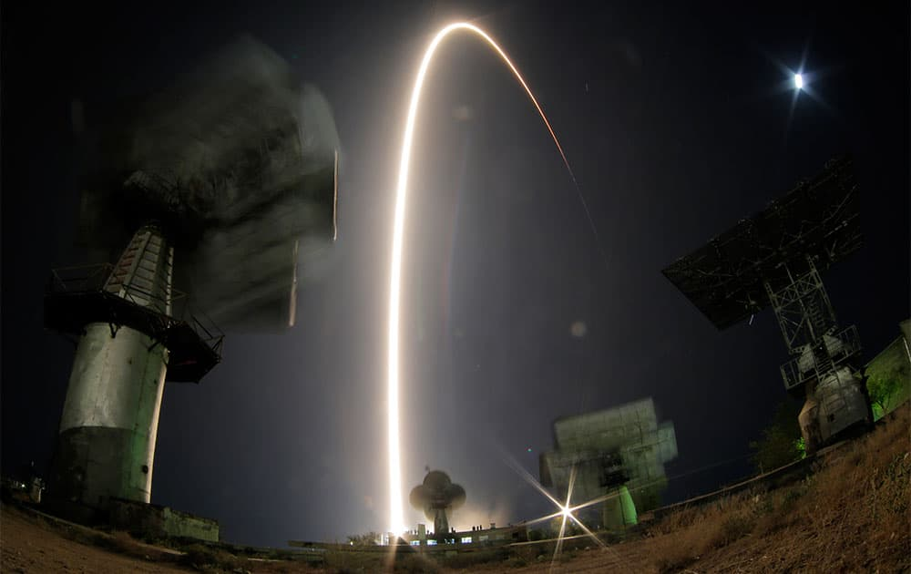 In this photo taken with a fisheye lens and with long time exposure the Soyuz-FG rocket booster with Soyuz TMA-10M space ship carrying a new crew to the International Space Station, ISS, blasts off at the Russian leased Baikonur cosmodrome, Kazakhstan.