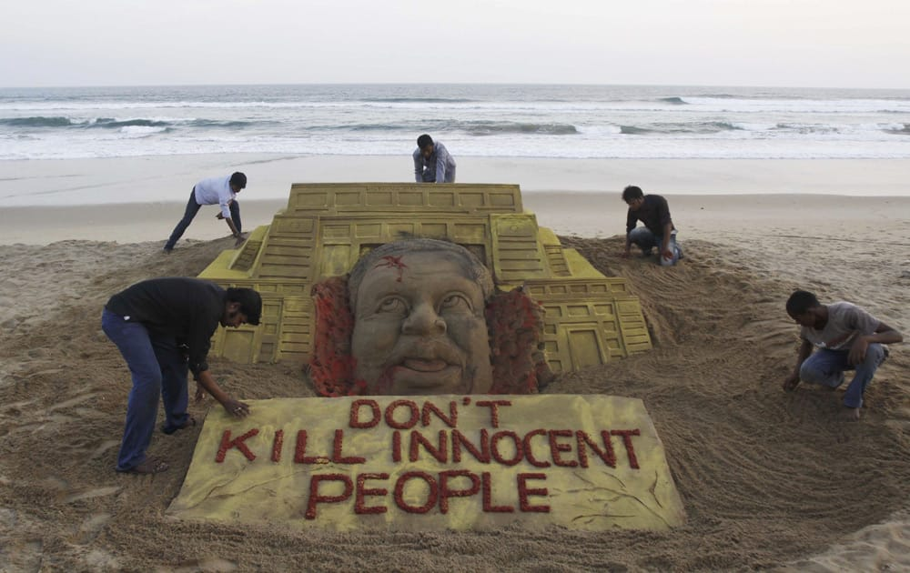 Sand artist Sudarshan Pattnaik and his team pay tributes to the victims of the terror attack on a Kenya mall by creating a sand sculpture on the Bay of Bengal coast in Puri.