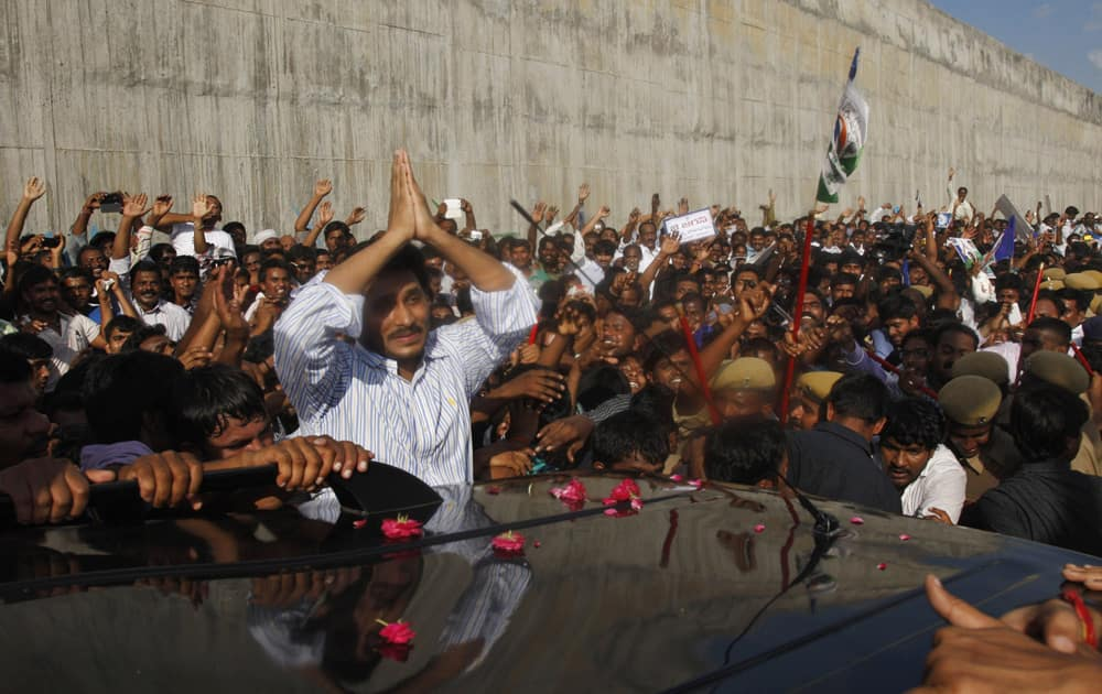 YSR Congress party chief Jagan Mohan Reddy greets supporters after he was released on bail from the Chanchalguda Central Prison in Hyderabad.