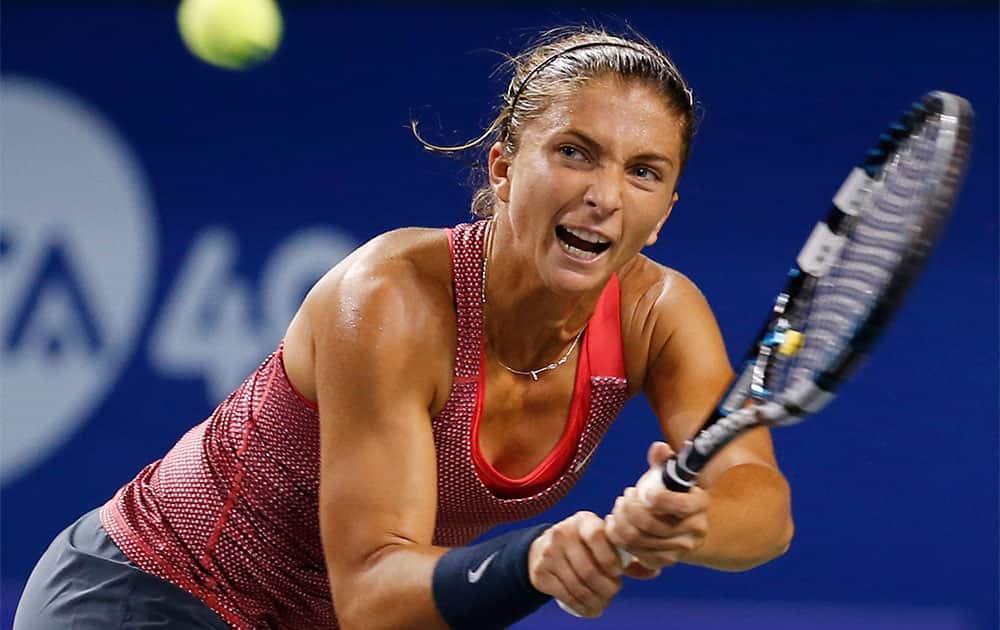 Sara Errani of Italy returns a shot against Svetlana Kuznetsova of Russia during their second round match of Pan Pacific Open Tennis tournament in Tokyo.