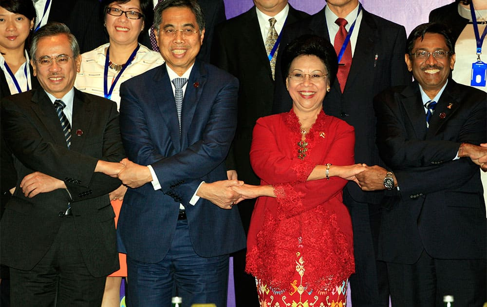 Health ministers pose for a group photo at the Asia-Pacific Economic Cooperation high level meeting on Health and the Economy in Bali, Indonesia.