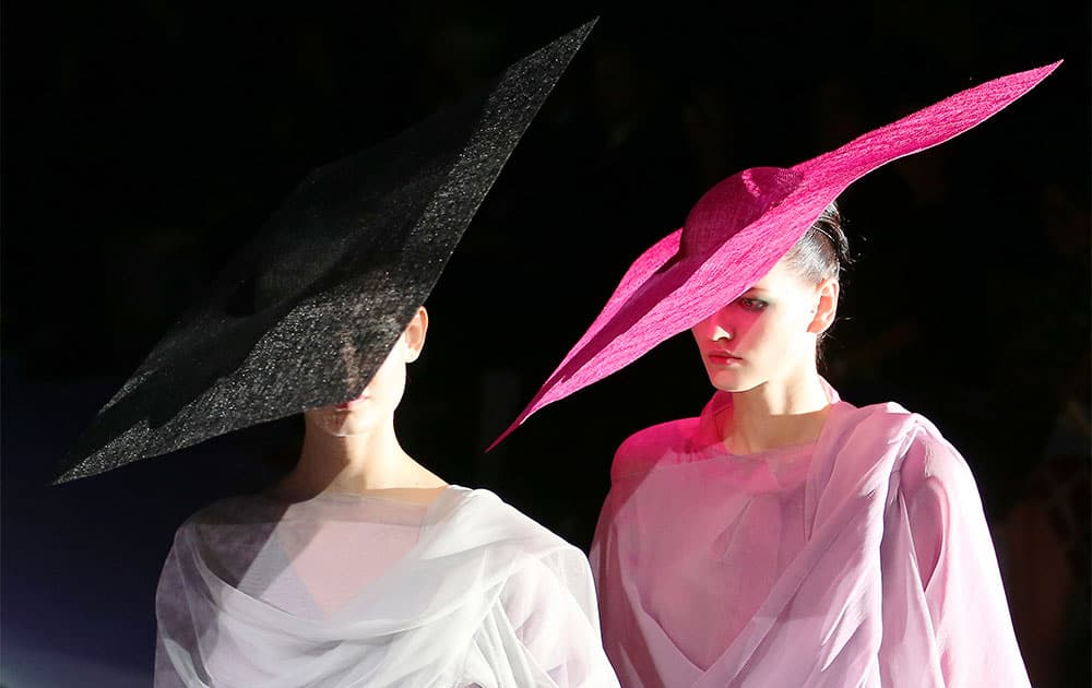 Models wear creations for Giorgio Armani women`s Spring-Summer 2014 collection, part of the Milan Fashion Week.