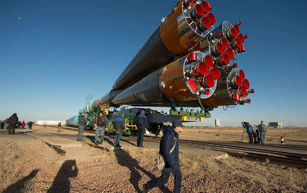 In this photo provided by NASA, the Soyuz rocket is rolled out to the launch pad by train,  at the Baikonur Cosmodrome in Kazakhstan.