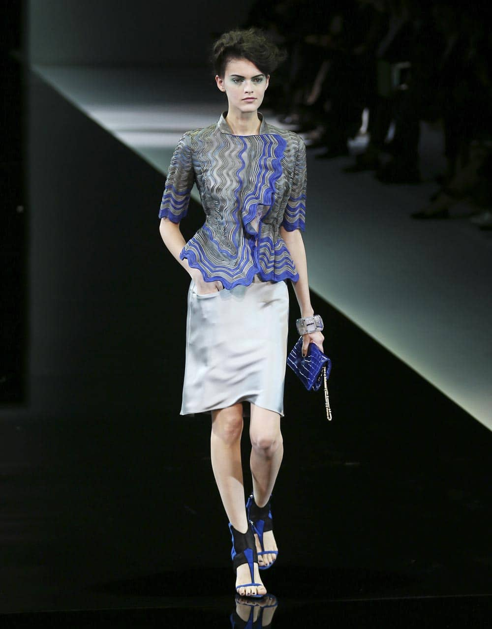 A model wears a creation for Giorgio Armani`s women`s Spring-Summer 2014 collection, part of the Milan Fashion Week.