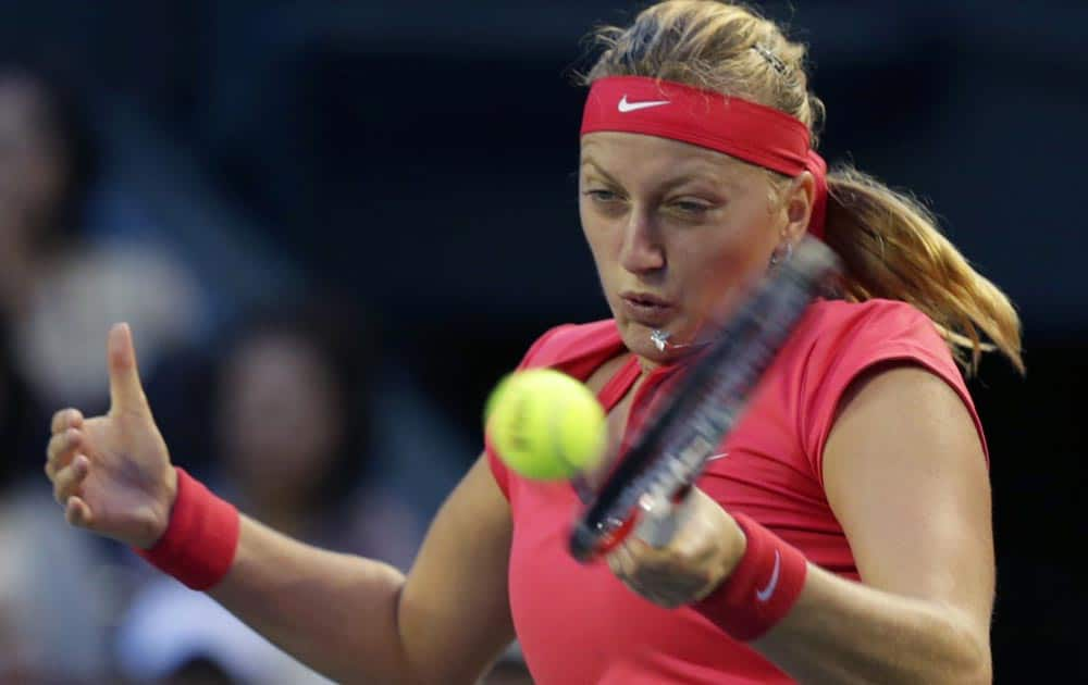 Petra Kvitova of the Czech Republic, returns the ball against Belinda Bencic of Switzerland during their first round match of Pan Pacific Open tennis tournament in Tokyo.