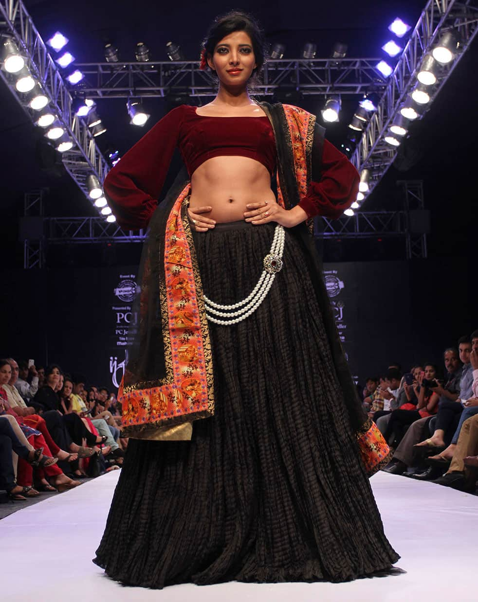 A model displays a creation by Sonia Mehra during the India Jewelry and Fashion Week in Ahmadabad.