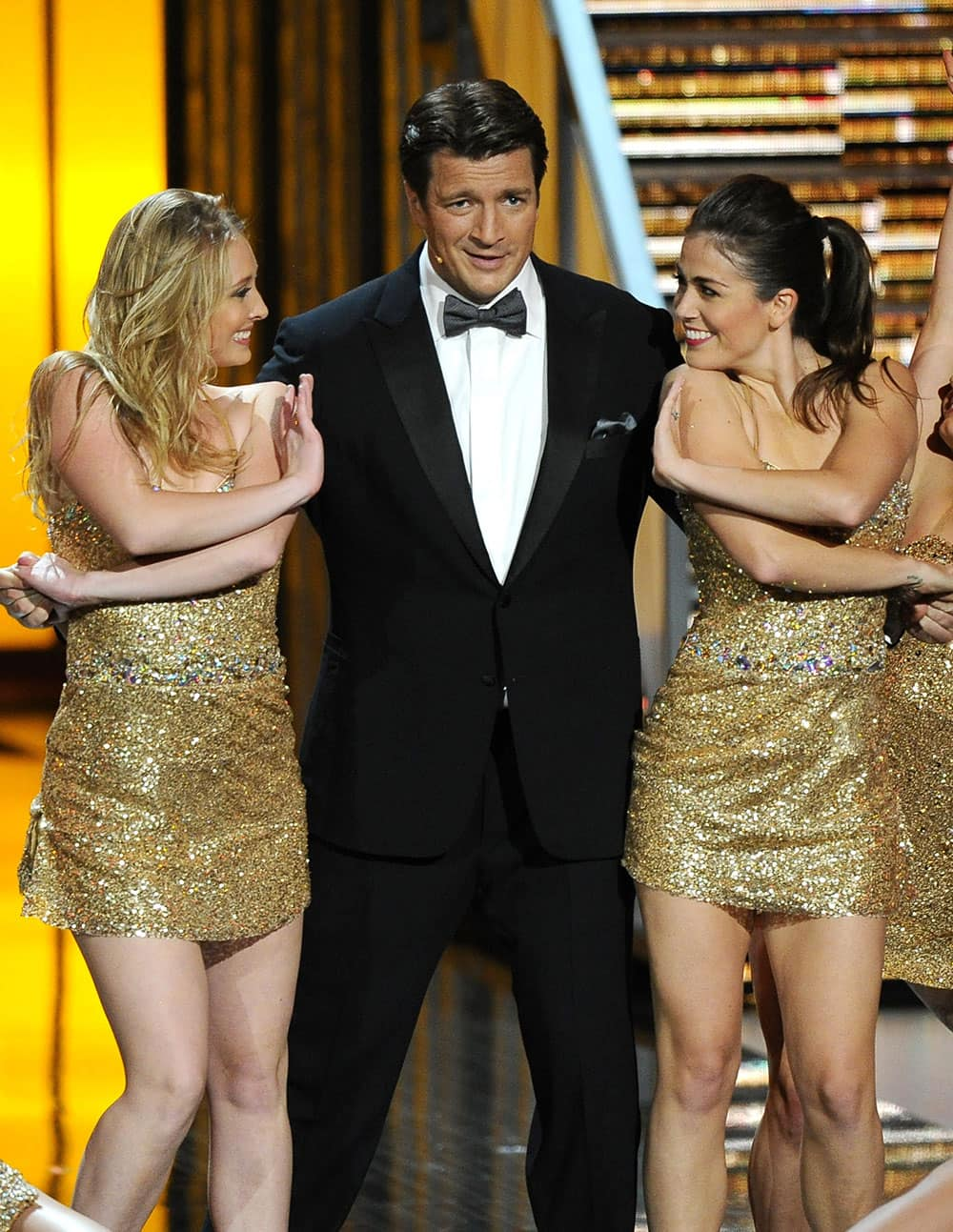 Nathan Fillion performs with dancers on stage at the 65th Primetime Emmy Awards at Nokia Theatre in Los Angeles.