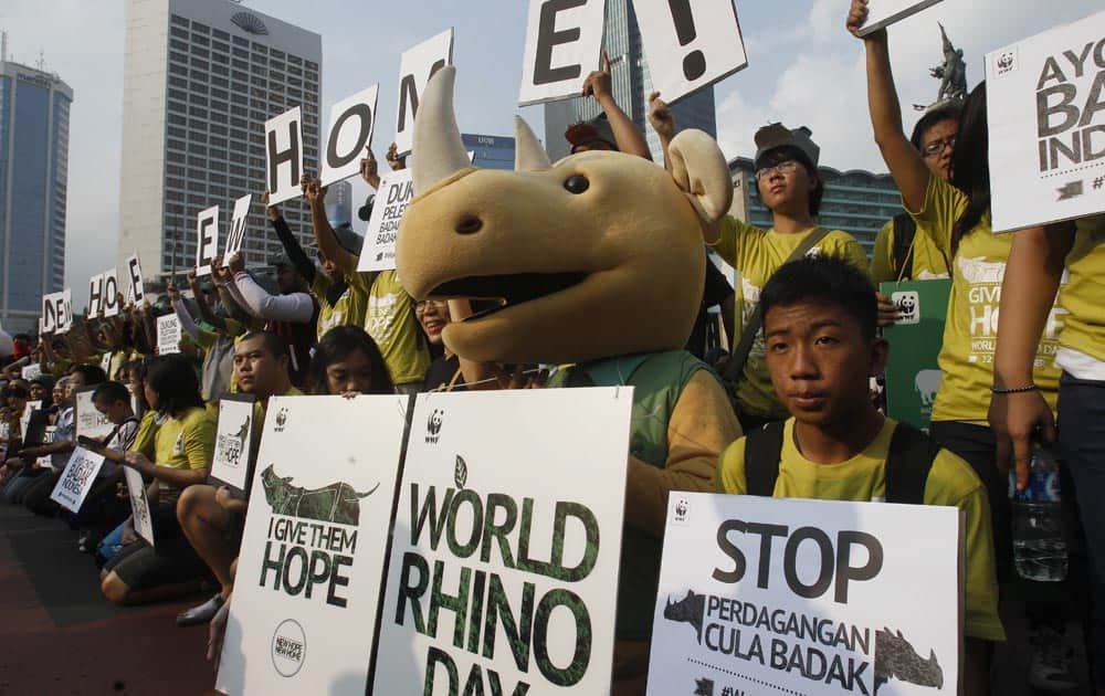 Activists hold banners during World Rhino Day in Jakarta. According to WWF, some 50 rhinoceros including calves are confirmed inhabiting at Ujung Kulon National Park in West Java.