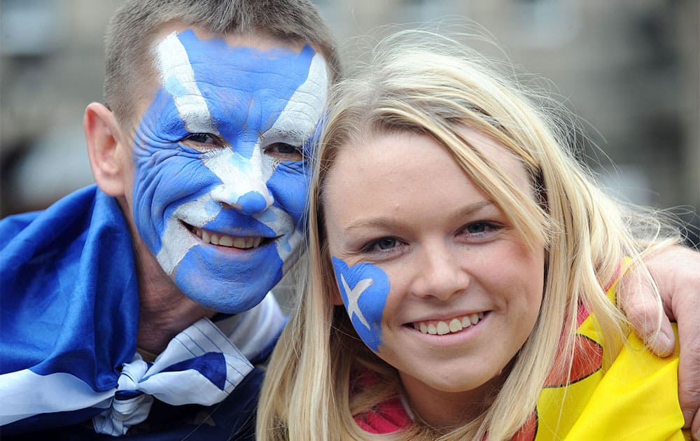 John Carroll and Stefanie (surname not given) from North Lanarkshire during a march and rally in Edinburgh, calling for a Yes vote in next year`s independence referendum.
