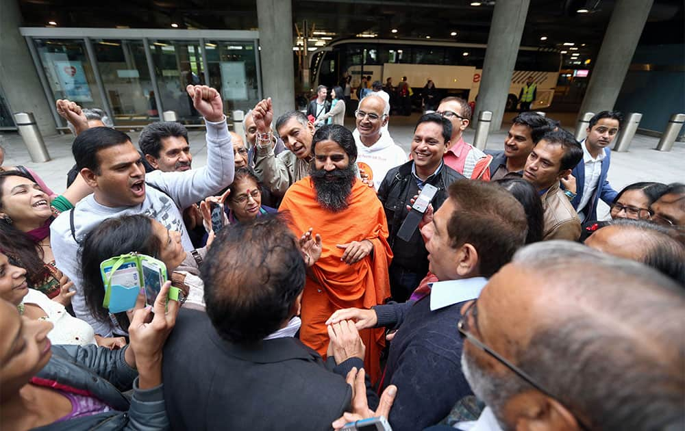 Yoga Guru Swami Ramdevji is greeted by supporters at Terminal 5 of London`s Heathrow Airport, after a meeting with immigration officials. Ramdevji, who is also known as Baba Ramdev has a reported 85 million strong worldwide following, was detained at Heathrow airport for eight hours after arriving from India, has now been allowed to stay in the country.