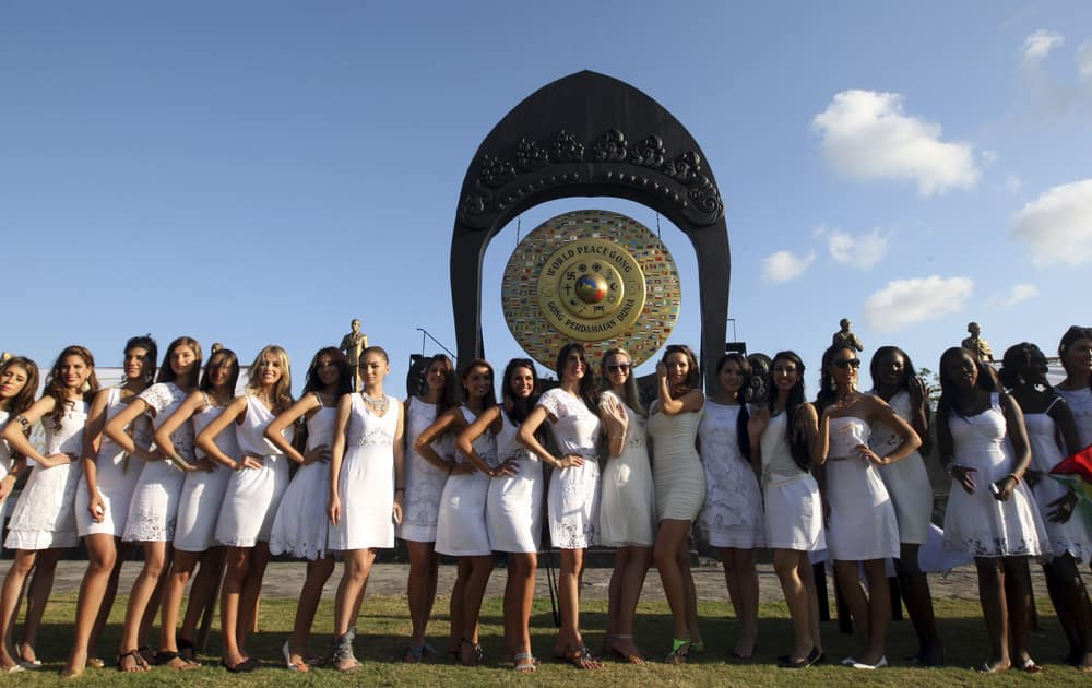 Miss World contestants pose for photos during the International World Peace Day celebrations at a park in Denpasar, Bali, Indonesia.