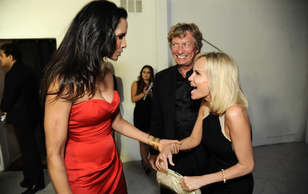 Padma Lakshmi, Nigel Lythgoe, and Kristen Chenoweth arrive at the 2013 Entertainment Weekly Pre-Emmy Party, presented by L`Oreal Paris and bebe at Fig & Olive in Los Angeles.