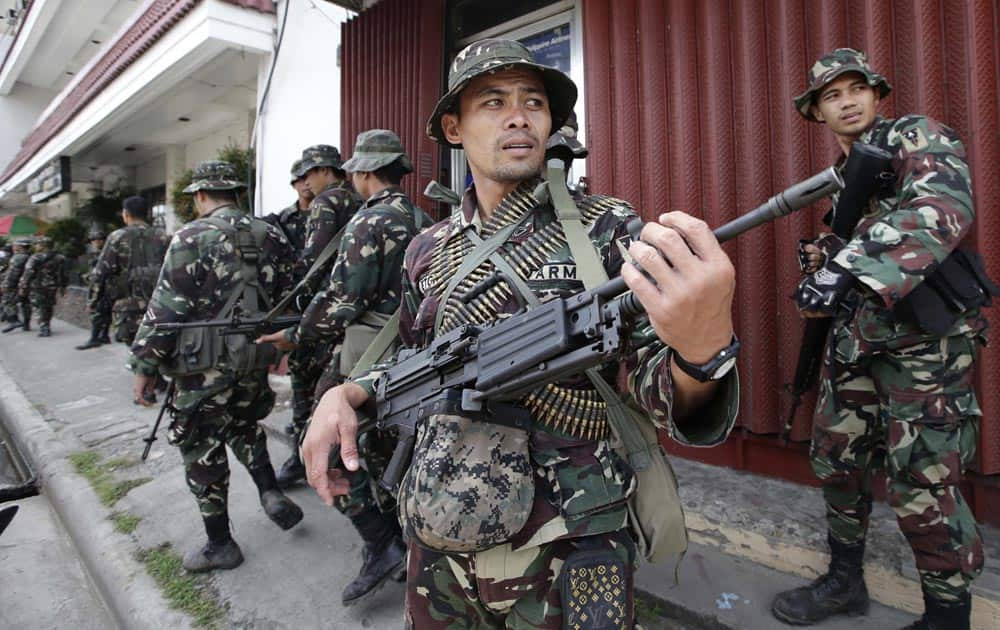 Government troopers patrol to secure the city streets as fighting between government forces and Muslim rebels continues, in Zamboanga city, in Philippines.