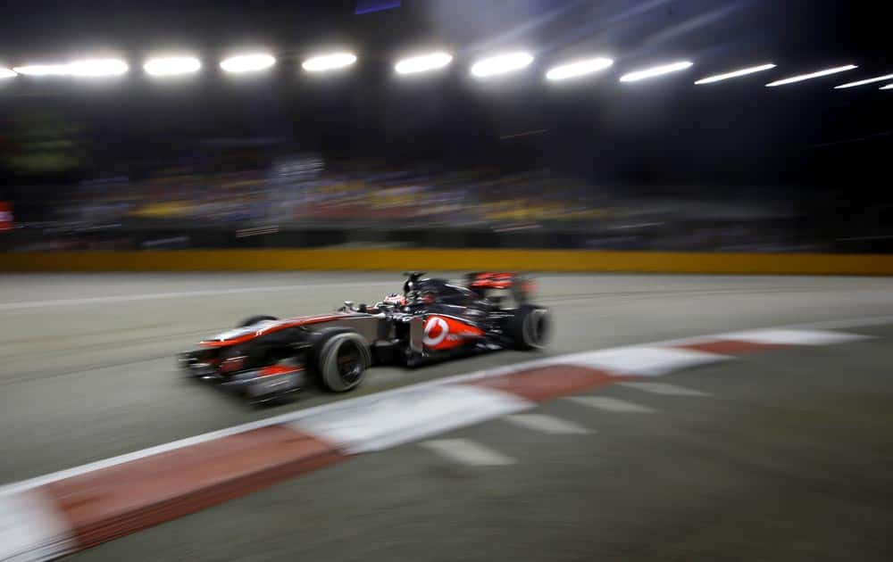 McLaren Mercedes driver Jenson Button of Britain steers his car during the second practice session at the Singapore.