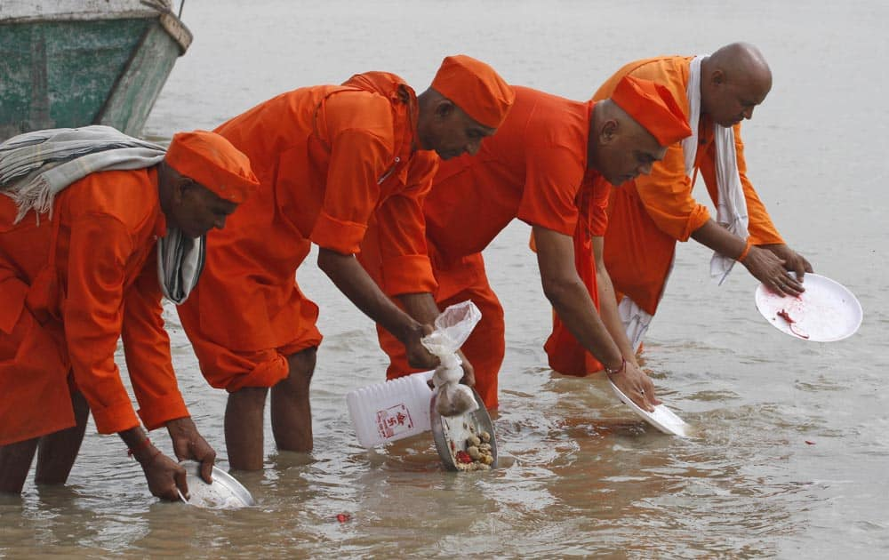 Hindu devotees perform Pind Daan rituals on the banks of the River Ganges in Allahabad.