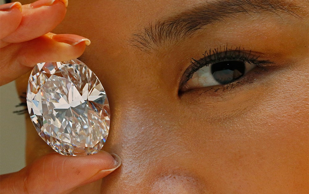 A 118.28-carat white diamond is displayed by a model at a press preview at Sotheby`s auction house in Hong Kong.