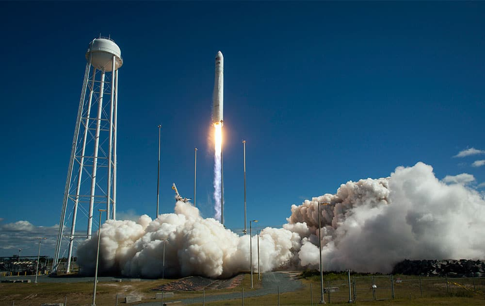 In this photo provided by NASA, the Orbital Sciences Corp. Antares rocket lifts off the launchpad at the NASA Wallops Island test flight facility in Wallops Island, Va.