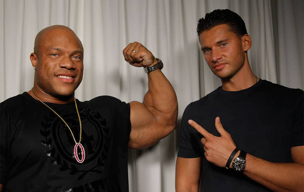 Director Vlad Yudin, right, and 2012 Mr. Olympia Phil Heath pose for a portrait in Los Angeles.