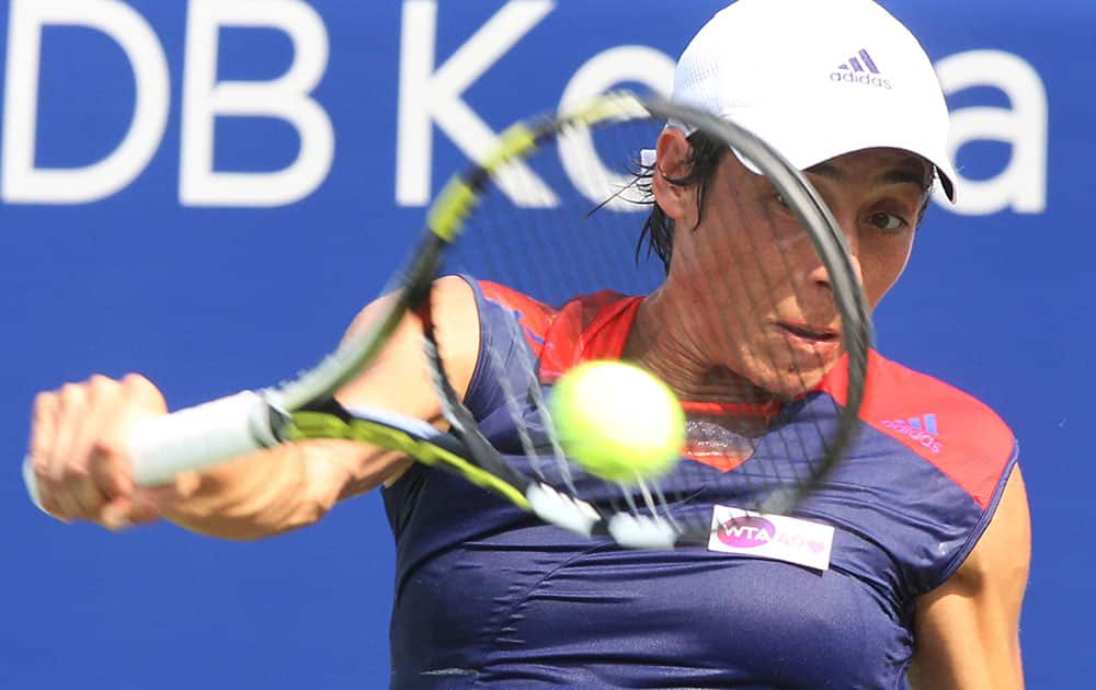 Italy`s Francesca Schiavone returns a shot against France`s Virginie Razzano during the second round match of the Korea Open tennis championships in Seoul, South Korea.