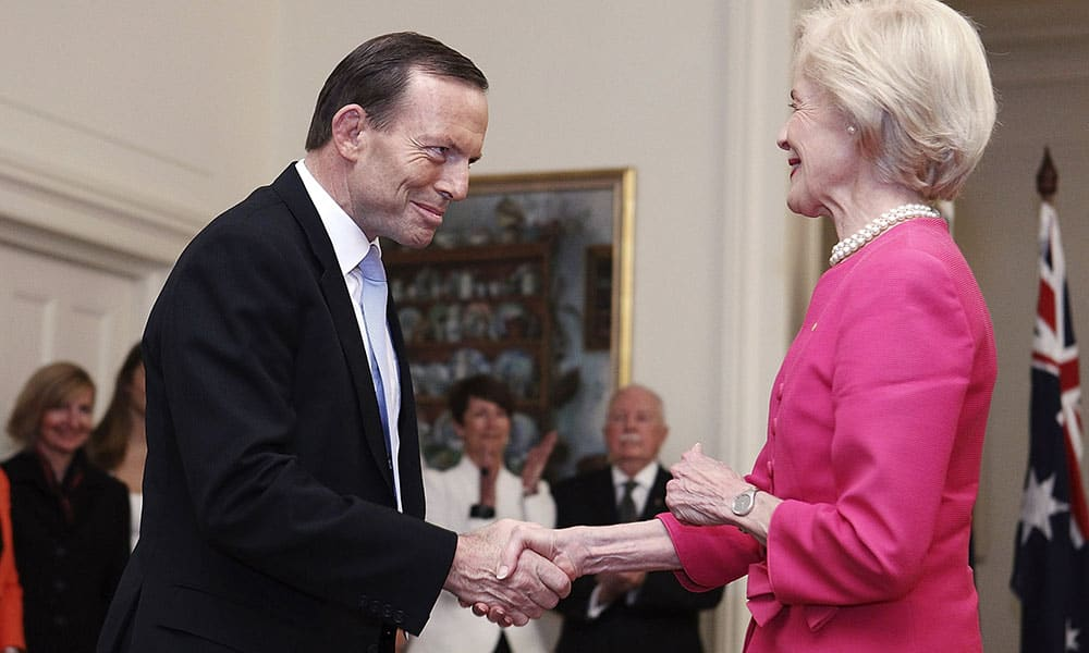 Tony Abbott, left, shakes hands with Governor General Quentin Bryce after being sworn in as the 28th prime minister of Australia at Government House in Canberra.