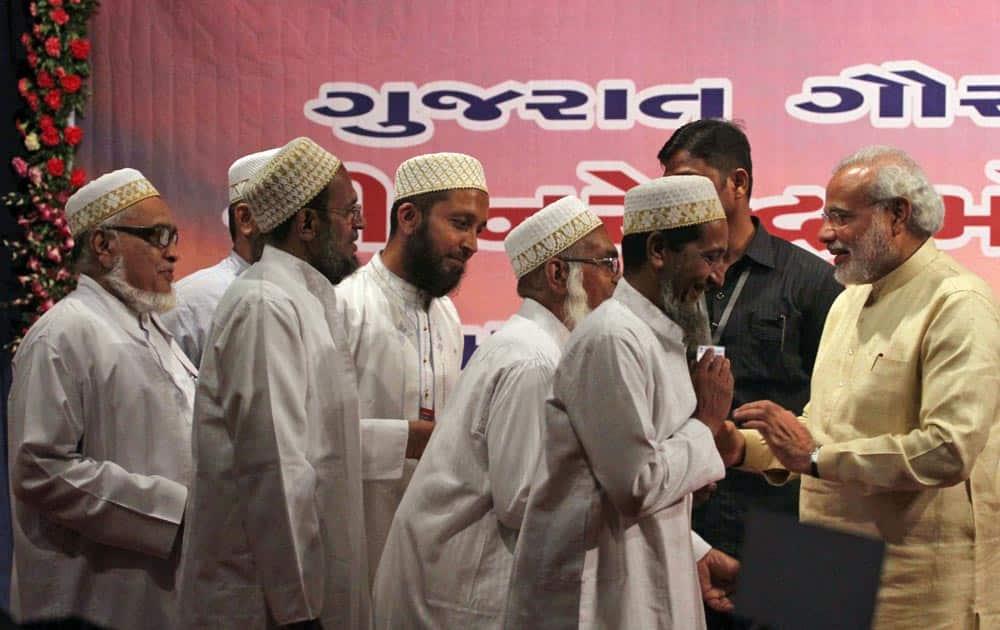 Muslims greet Gujarat state Chief Minister Narendra Modi, during a function to celebrate his birthday in Gandhinagar.