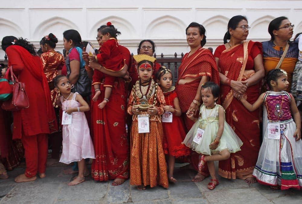 Young Nepalese girls with their mothers wearing new cloths wait for Kumari puja at Hanuman Dhoka, Basantapur Durbar Square, Katmandu.
