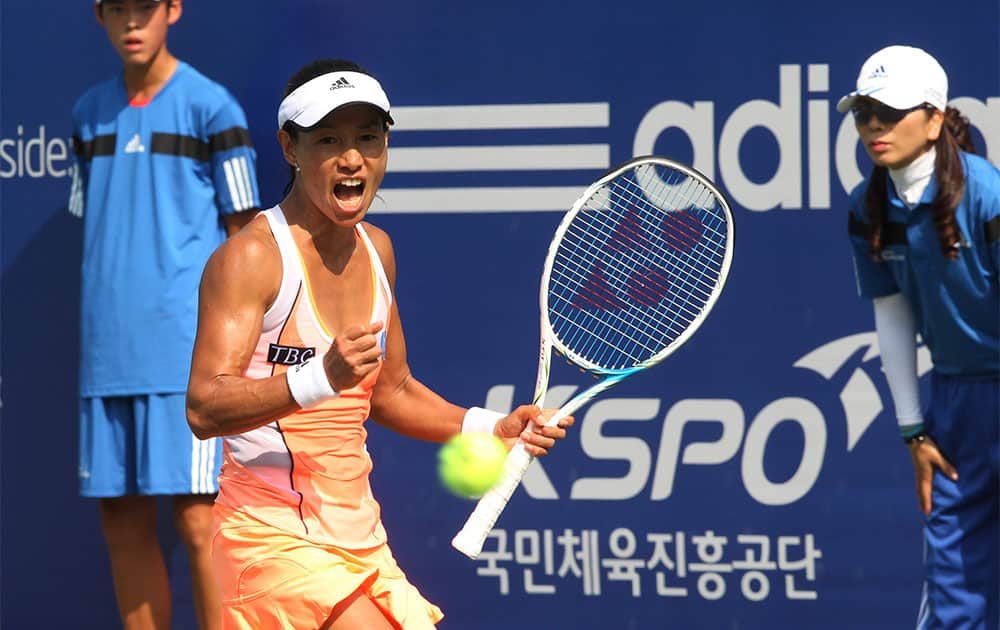Japan`s Kimiko Date Krumm shouts after winning against Great Britain`s Heather Watson during the first round match of the Korea Open tennis championships in Seoul, South Korea. Date Krumm won the match with 3-6, 6-3, 6-4.