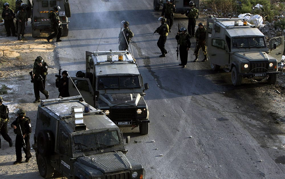 Israeli soldiers gather during an operation in the Jenin refugee camp, near the West Bank city of Jenin.