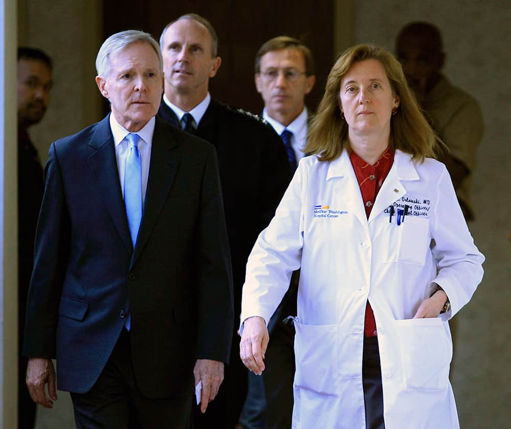 Secretary of the Navy Ray Mabus and Washington Hospital Center chief operating officer Janis M. Orlowski walk to a news conference in Washington, after visiting the people injured in the shooting at Washington Navy Yard.