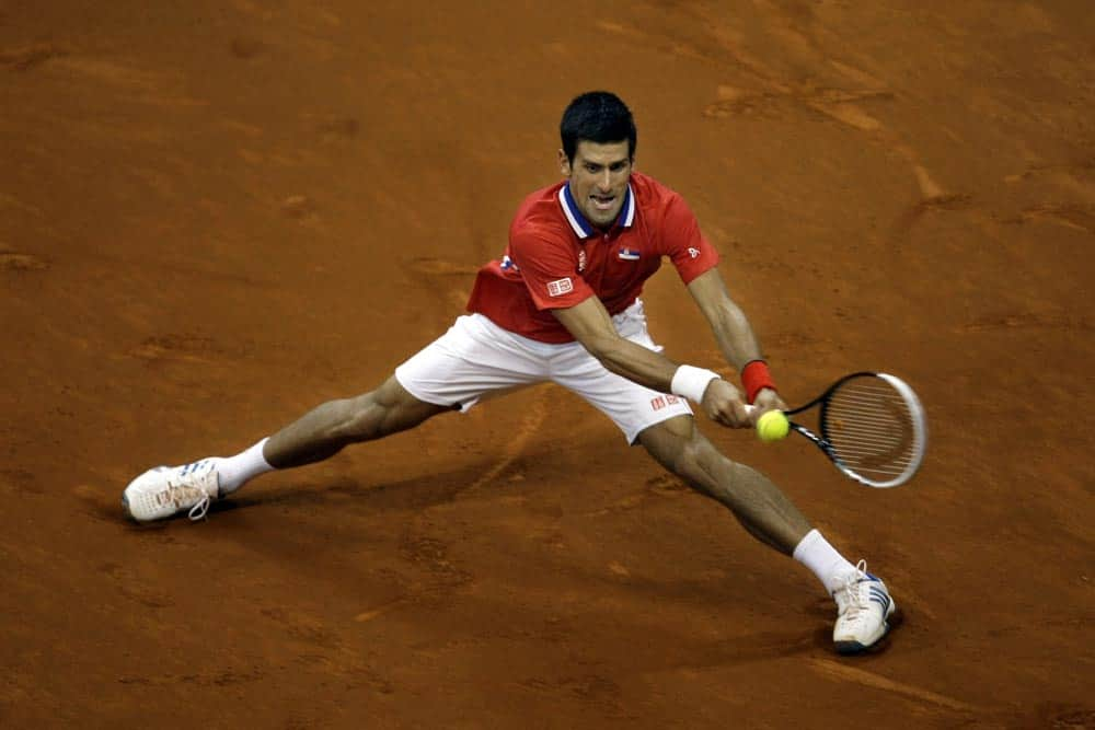 Serbia`s Novak Djokovic returns the ball to Canada`s Milos Raonic during their Davis Cup semifinals tennis match in Belgrade, Serbia.