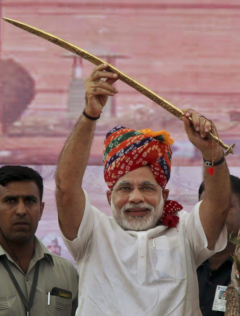 Gujarat Chief Minister Narendra Modi raises a sword that was presented to him at a rally in Rewari, Haryana state.