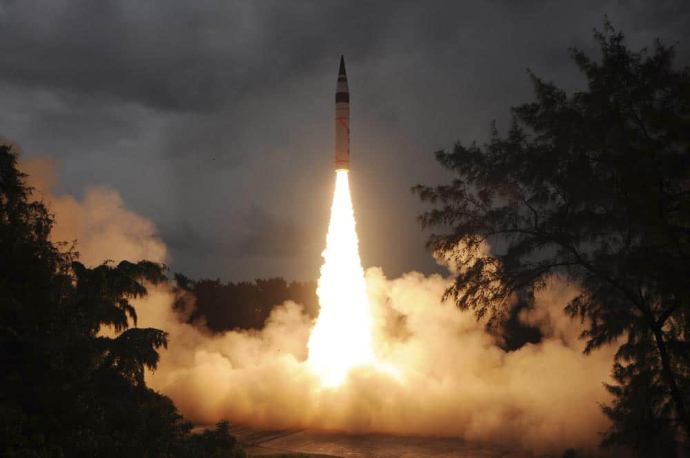 This photo released by India`s Defence Research and Development Organisation (DRDO), India's nuclear-capable missile Agni-V is test fired in Wheelar's Island, off the coast of Odisha.
