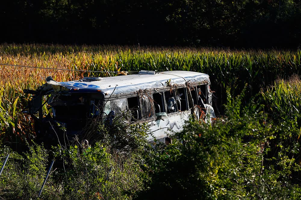 A crew works to remove an overturned Greyhound bus from a field following a crash along interstate 75 in Liberty Township, Ohio. At least 35 people were injured in the accident.
