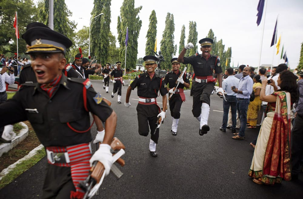 Cadets celebrate after a graduation ceremony at Officers Training Academy in Chennai. A total of 350 cadets graduated and will be posted as Lieutenants in the Indian Army.