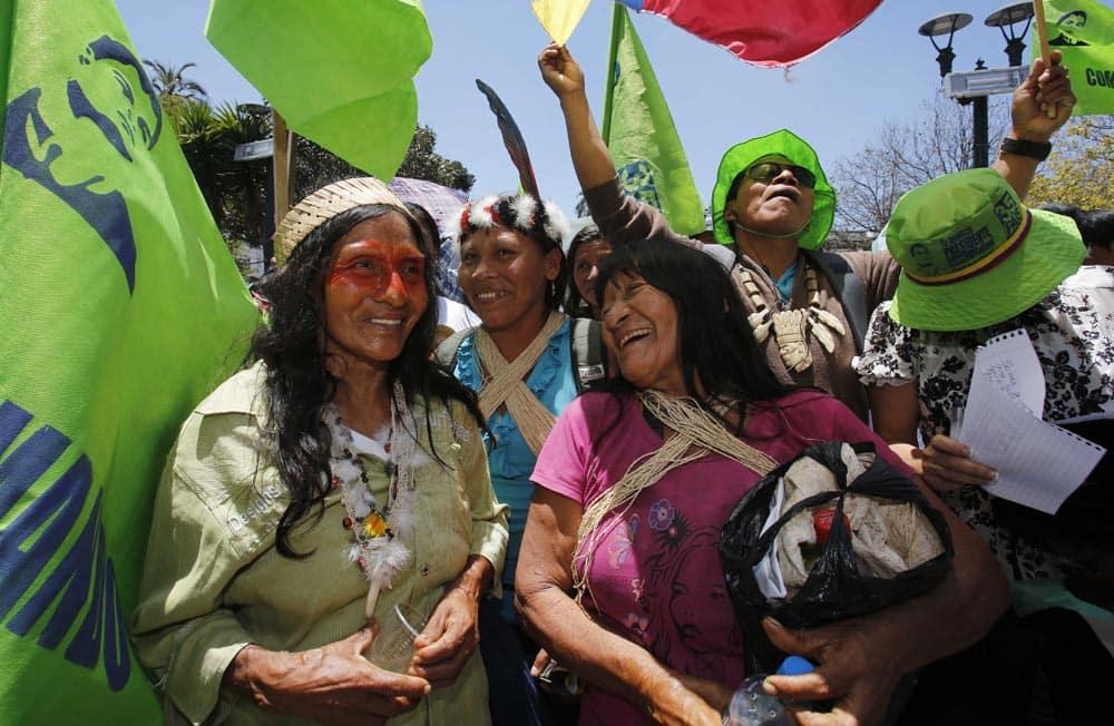 Waoranis women laugh as they participate in a march in Quito, Ecuador.
