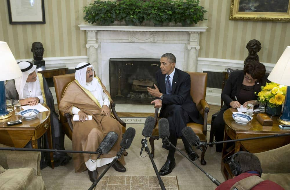 President Barack Obama talks with the Kuwait Amir Sheik Sabah Al Ahmed Al Sabah during their meeting in the Oval Office of the White House in Washington.