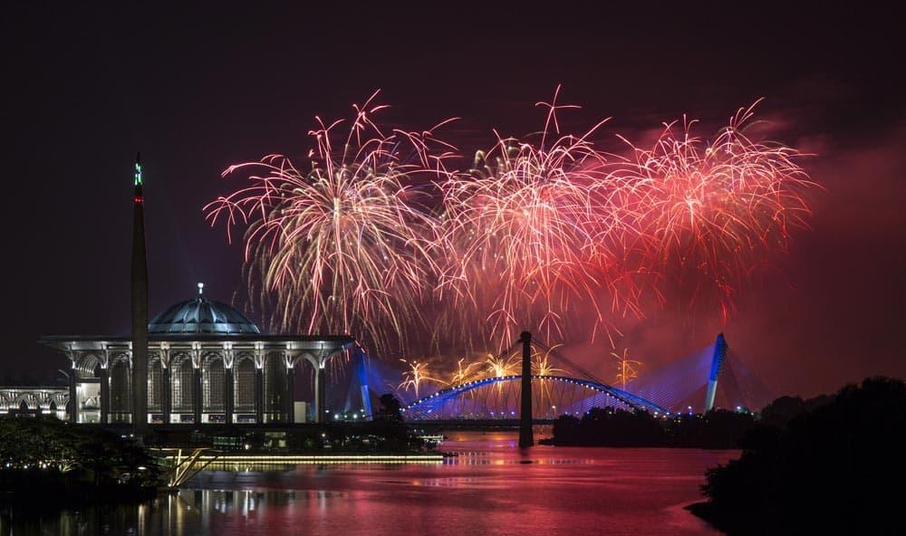 Team France presents fireworks over Malaysia`s landmark Putrajaya Millennium Monument, Tuanku Mizan Zainal Abidin Mosque, left, and Seri Saujana Bridge during the Putrajaya International Fireworks Competition at the administrative capital of Putrajaya outside Kuala Lumpur.