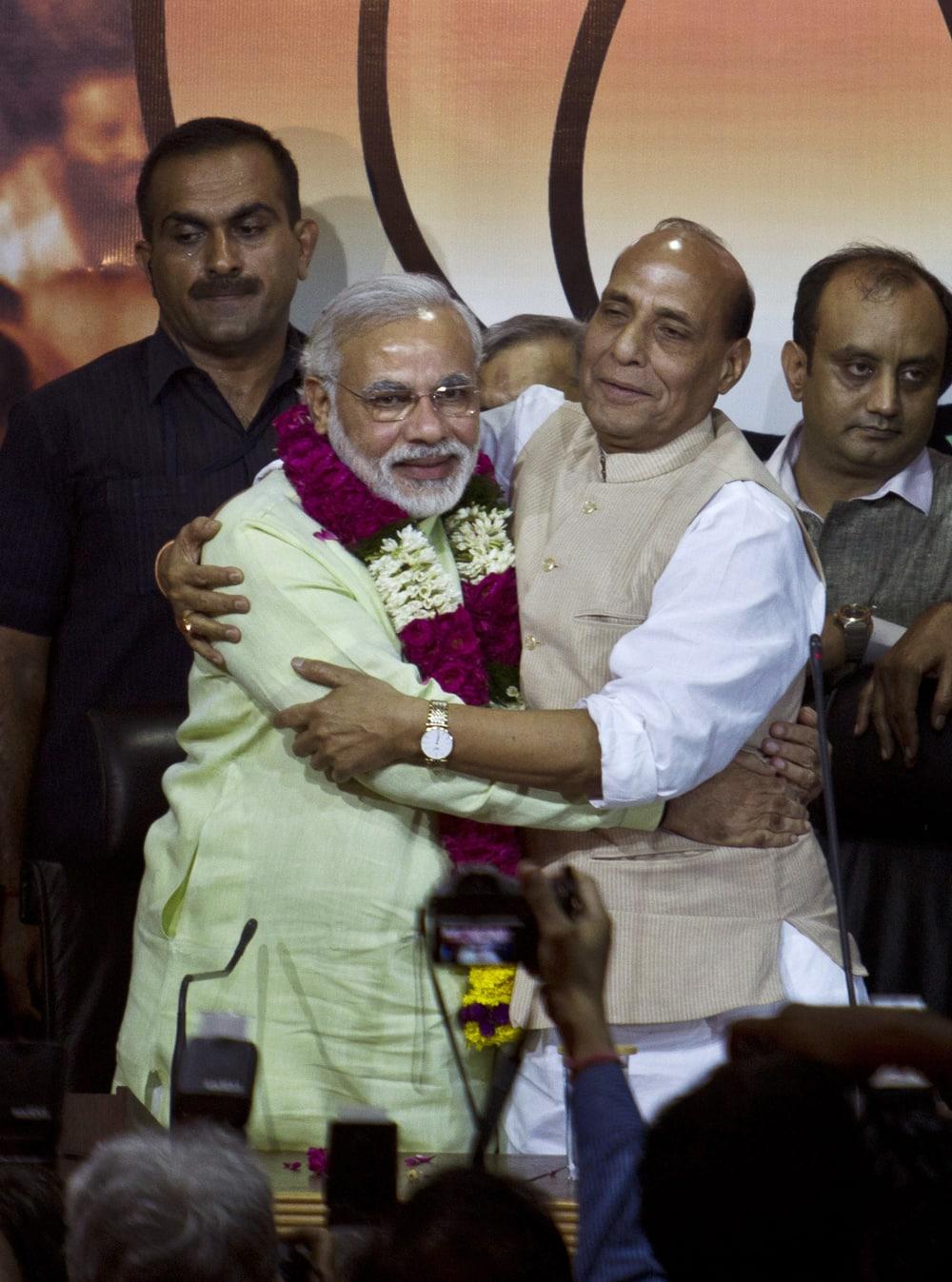 Bharatiya Janata Party (BJP) president Rajnath Singh hugs Gujarat state Chief Minister Narendra Modi after garlanding him in New Delhi.