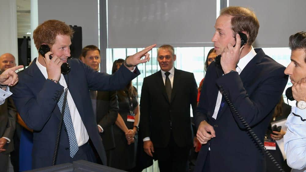 Britain`s Prince William, Duke of Cambridge, right and his brother Prince Harry take part in a trade on the BGC Partners trading floor, during the BGC Charity Day 2013, in Canary Wharf, London.