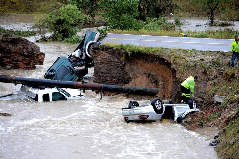A bridge collapse after flash flooding on a business access road at Highway 287 and Dillon Road at the Broomfield/Lafayette border, Colo.