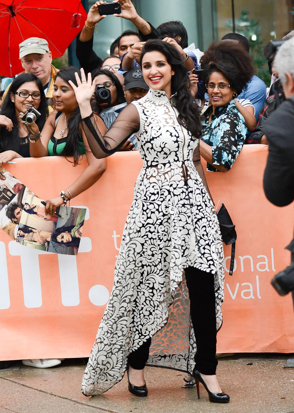 Parineeti Chopra, greets her fans at the premiere of