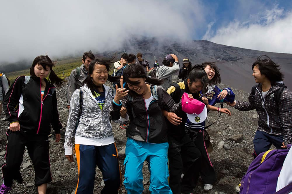 Japanese students make their way down a steep trail on Mount Fuji in Japan during a school putting to learn about the mountain environment and pick up any trash they could find on the trails.