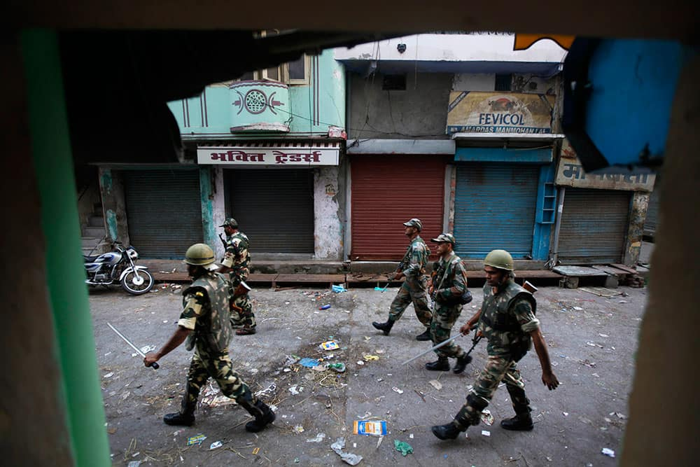 Indian army soldiers patrol during a curfew imposed following deadly clashes between Hindus and Muslims at Muzaffarnagar in Uttar Pradesh state, India.
