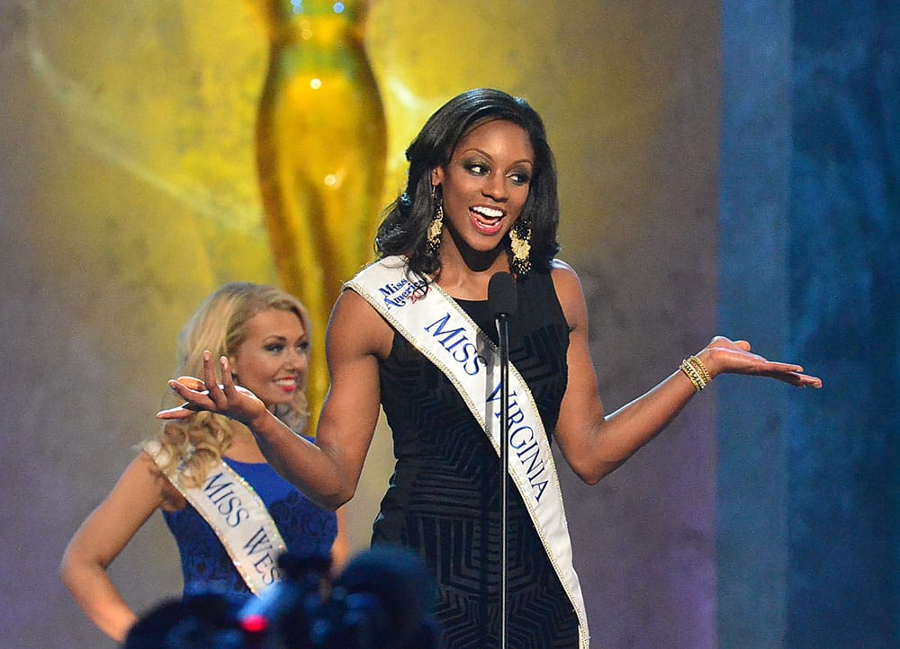Miss Virginia, Desiree Williams, speaks during the preliminary competition of the Miss America Pageant at Boardwalk Hall in Atlantic City, N.J.