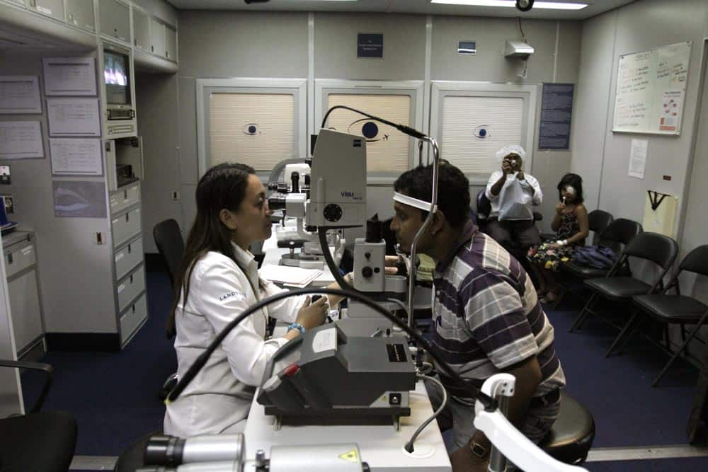 An Orbis eye care professional, left, examines eyes of an Indian patient inside the Orbis flying eye hospital in Kolkata.